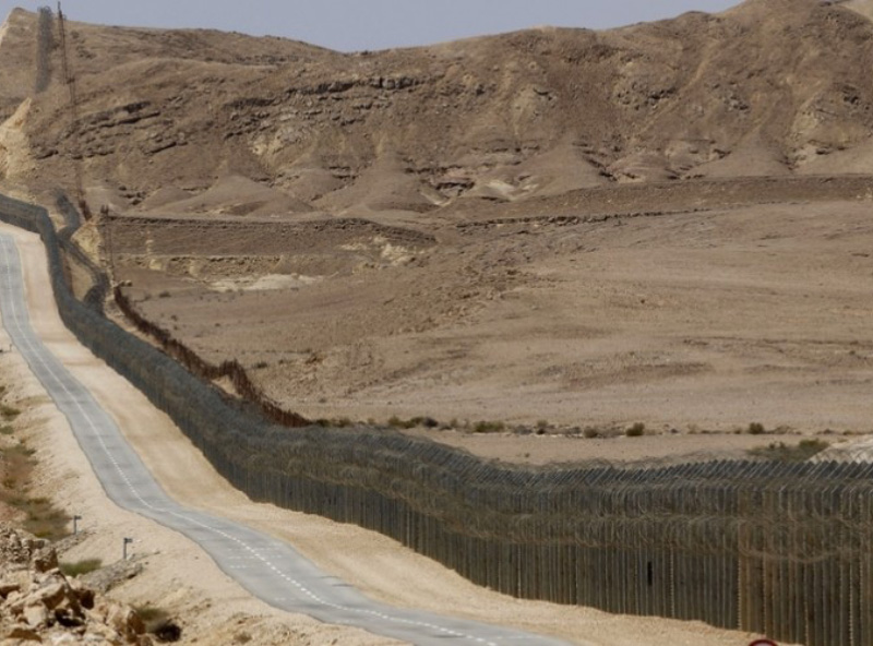Picture of security fence on border beside a road
